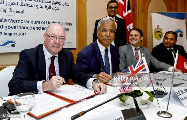 British minister of state for the Middle East and North Africa Alistair Burt signs a memorandum of understanding on audit and control for good...