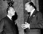 British Minister of State John Profumo and the Duke of Pastrana the Lord Mayor of Madrid chatting at a government luncheon at Lancaster House London...