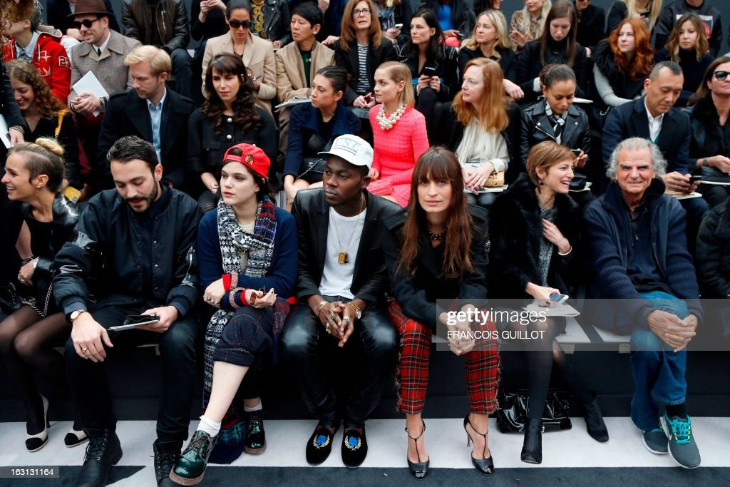 British model Alice Dellal, a guest, French singer and actress Soko, US rapper Theophilus London, French model and music producer Caroline de Maigret, a guest and French photographer Patrick Demarchelier attend on March 5, 2013 Chanel's Fall/Winter 2013-2014 ready-to-wear collection show at the Grand Palais in Paris.