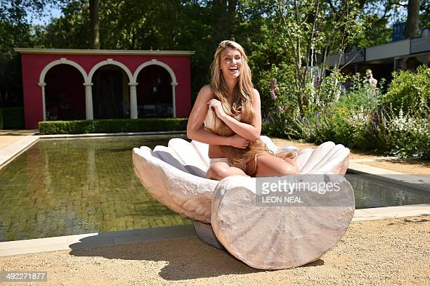 British model Amy Willerton strikes a pose to imitate the painting 'Birth of Venus' by Botticelli as she poses for photographers at the Chelsea...