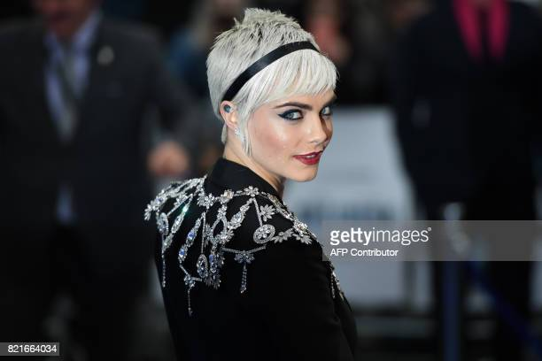 TOPSHOT British model and actress Cara Delevingne poses for a photograph upon arrival for the European premiere of 'Valerian and The City of a...