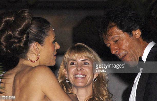 British model and actress Elizabeth Hurley speaks with former Pakistani cricketer Imran Khan as an unidentified guest looks on at a party hosted by...