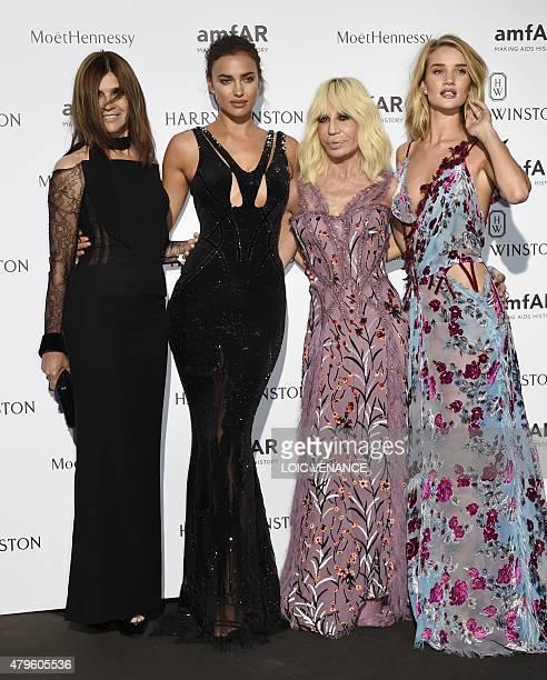British model and actress Rosie HuntingtonWhiteley Italian fashion designer Donatella Versace French stylist Carine Roitfeld and Russian model Irina...
