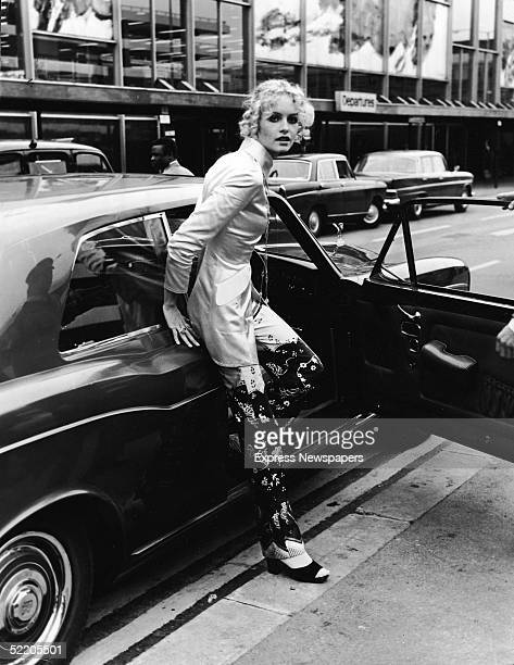 British model and actress Twiggy steps from a Rolls Royce car at an airport shortly after retiring from modelling October 3 1970