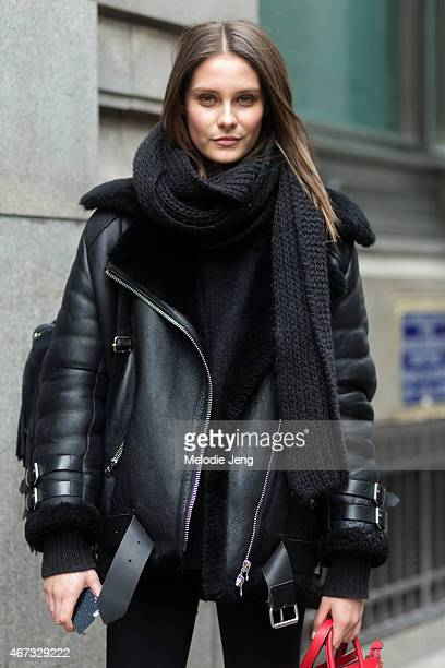 British model Charlotte Wiggins exits the Emilia Wickstead show in an Acne Studios shearling jacket and Celine bag during London Fashion Week...