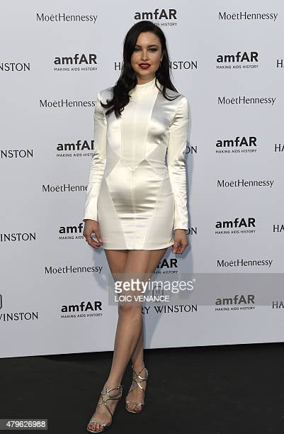British model Emma Miller arrives for the amfAR dinner on the sidelines of the Paris fashion week in Paris on July 5 2015 AFP PHOTO / LOIC VENANCE