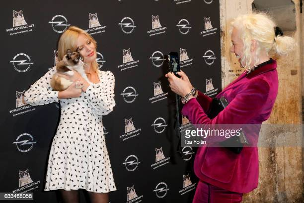 British Model Georgia May Jagger with Grumpy cat and photographer Ellen von Unwerth attend the Presentation of the new Opel Calender 2017 at...