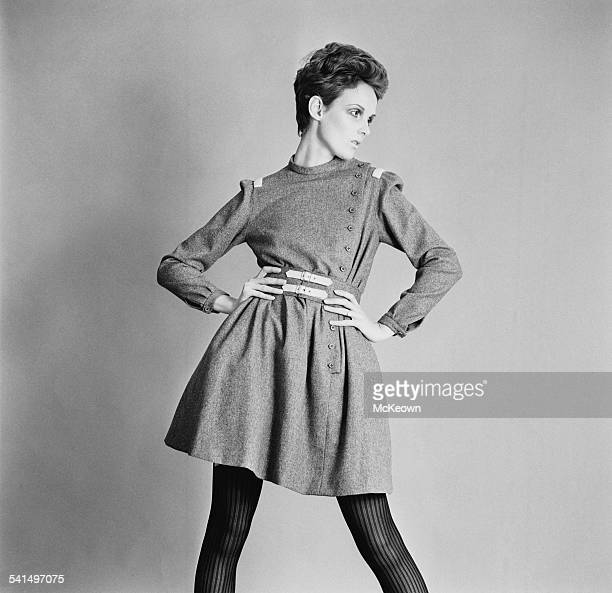 British model Grace Coddington showing a grey flannel day dress and buckle belt by Christiane Bailly 18th April 1967