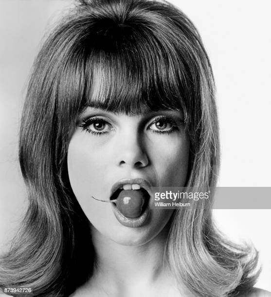 British model Jean Shrimpton posing with a radish in her mouth 1964