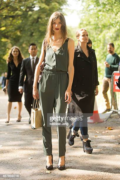 British model Jessica Burley exits the Burberry fashion show at Kensington Gardens on Day 4 of London Fashion Week Spring Summer 2015 on September 15...