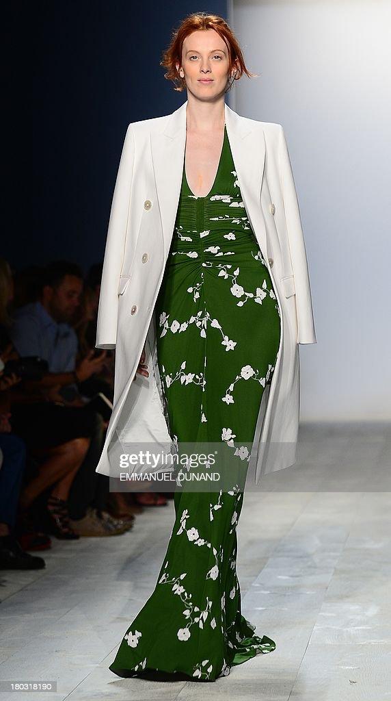 British model Karen Elson displays creations by designer Michael Kors during the Mercedes-Benz Fashion Week Spring 2014 collection in New York on September 11, 2013. AFP PHOTO/Emmanuel Dunand