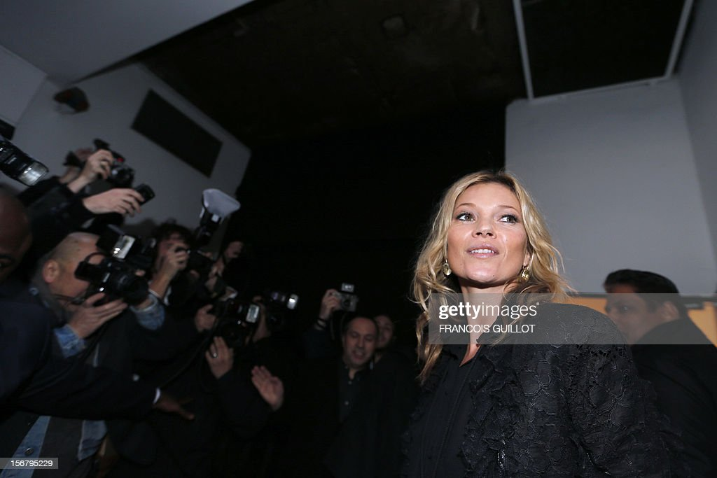 British model Kate Moss arrives to attend a book signing session for the release of her book 'Kate: The Kate Moss Book' on November 21, 2012 at the Colette store in Paris.