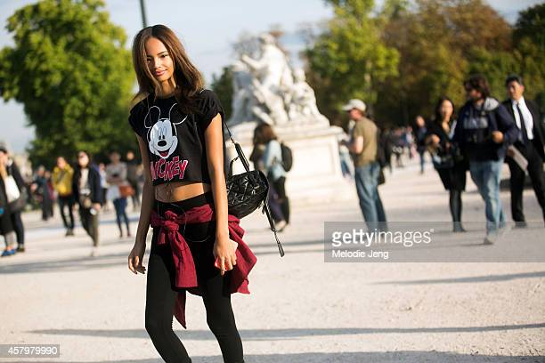 British model Malaika Firth exits Nina Ricci at the Tuileries on Day 3 of Paris Fashion Week Spring/Summer 2015 on September 24 2014 in Paris France