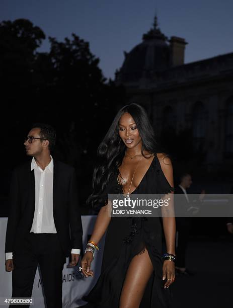 British model Naomi Campbell arrives to take part in the Amfar dinner on the sidelines of the Paris fashion week on July 5 2015 in Paris AFP PHOTO /...