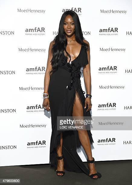 British model Naomi Campbell poses as she arrives to take part in the Amfar dinner on the sidelines of the Paris fashion week on July 5 2015 in Paris...