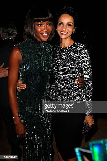 British model Naomi Campbell poses with French actress and former model Farida Khelfa at the launching of the exhibition 'Alaia' dedicated to French...