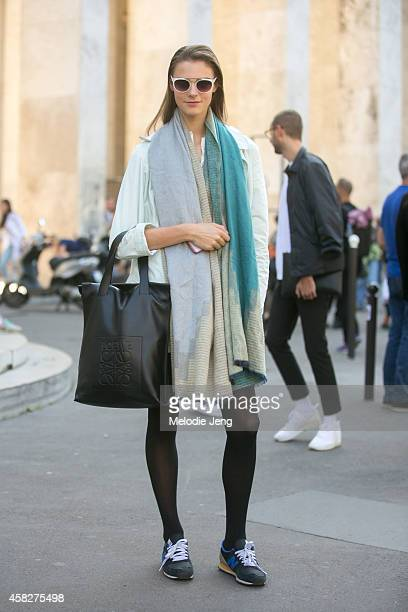 British model Olivia David exits the Acne Studios show at Palais de Tokyo carrying a Loewe tote bag and wearing New Balance sneakers on Day 5 of...
