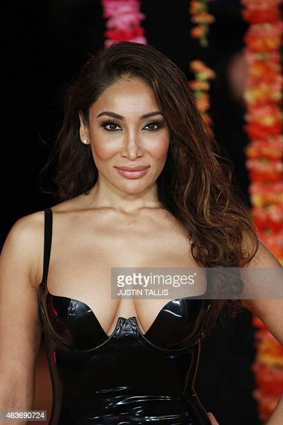 British model Sofia Hayat poses for photographers on the red carpet ahead of the Royal and World Premiere of the film 'The Second Best Exotic...