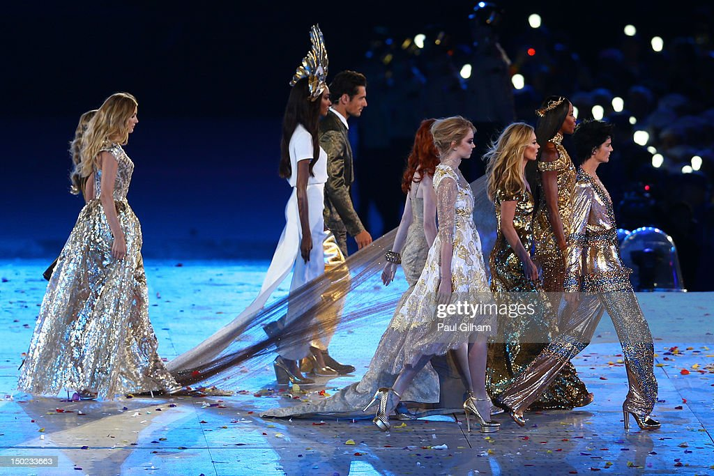 British model Stella Tennant, British model Lily Cole, British model Karen Elson, British model Naomi Campbell, British model Jourdon Dunn, British model David Gandy and British model Kate Moss perform during the Closing Ceremony on Day 16 of the London 2012 Olympic Games at Olympic Stadium on August 12, 2012 in London, England.