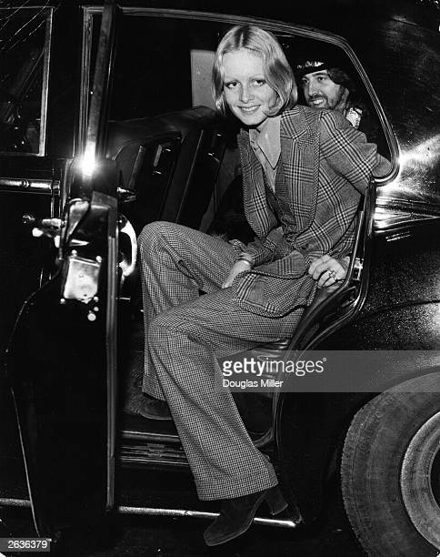 British model Twiggy getting into her car at London Airport