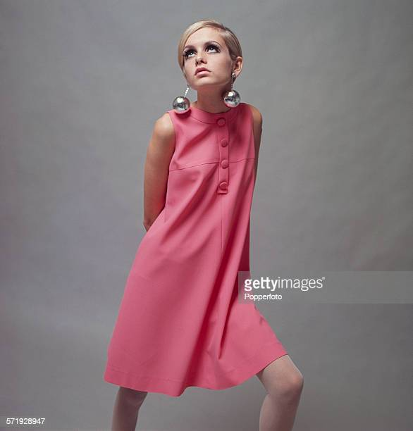 British Model Twiggy wearing a pale pink mini dress and large 'bauble' earrings 3rd December 1966 Photo by Popperfoto/Getty Images