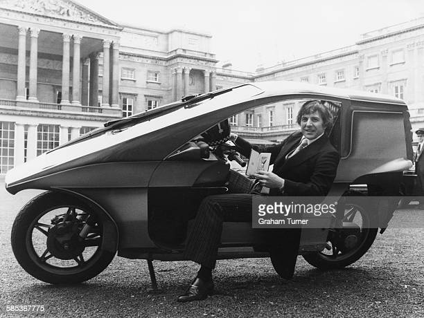 British motorcycle racer Phil Read seated on his special motorcycle outside Buckingham Palace after receiving his investiture from Queen Elizabeth II...