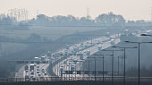 British motorway in a rush hours, in a foggy afternoon