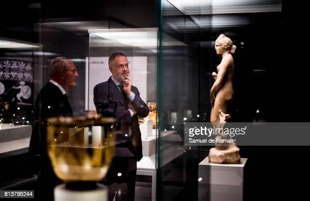 British museum director Hartwig Fischer and art expert Peter Higgs watch a sculpture during 'Agon La Competicion En La Antigua Grecia ' Art...