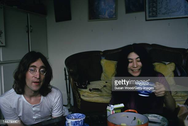British musican and artist John Lennon and Japaneseborn artist and musician Yoko Ono drink from porcelain tea cups December 1968