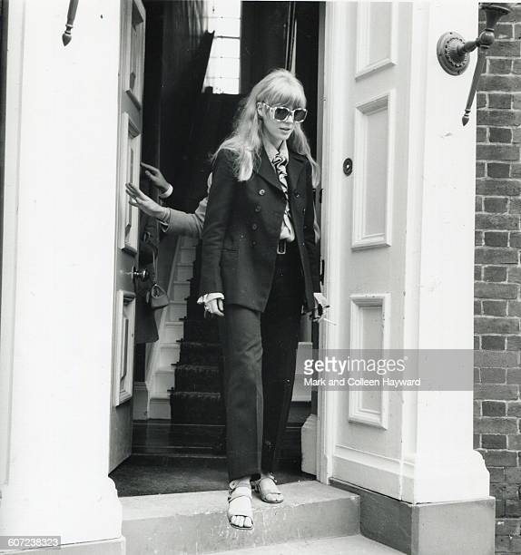 British musician and actress Marianne Faithfull wears an oversize pair of sunglasses as she steps out of a doorway June 30 1967