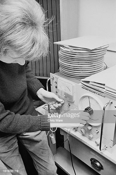 British musician and composer John Baker adjusts an audio sweep oscillator and controller at the BBC Radiophonic Workshop at the BBC's Maida Vale...