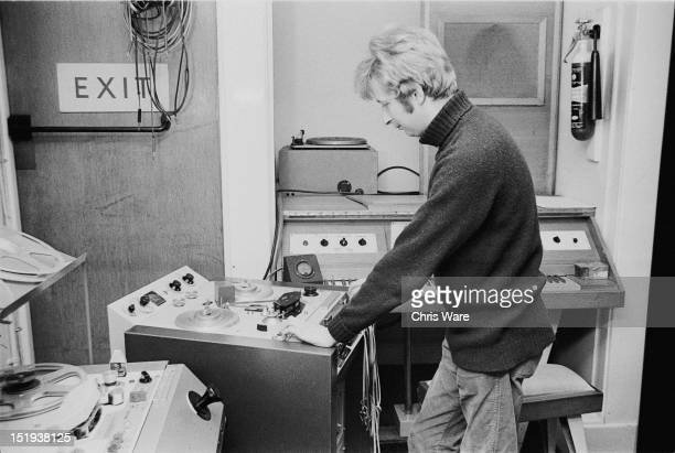 British musician and composer John Baker changes the pitch of a sound on a variable speed tape machine at the BBC Radiophonic Workshop at the BBC's...