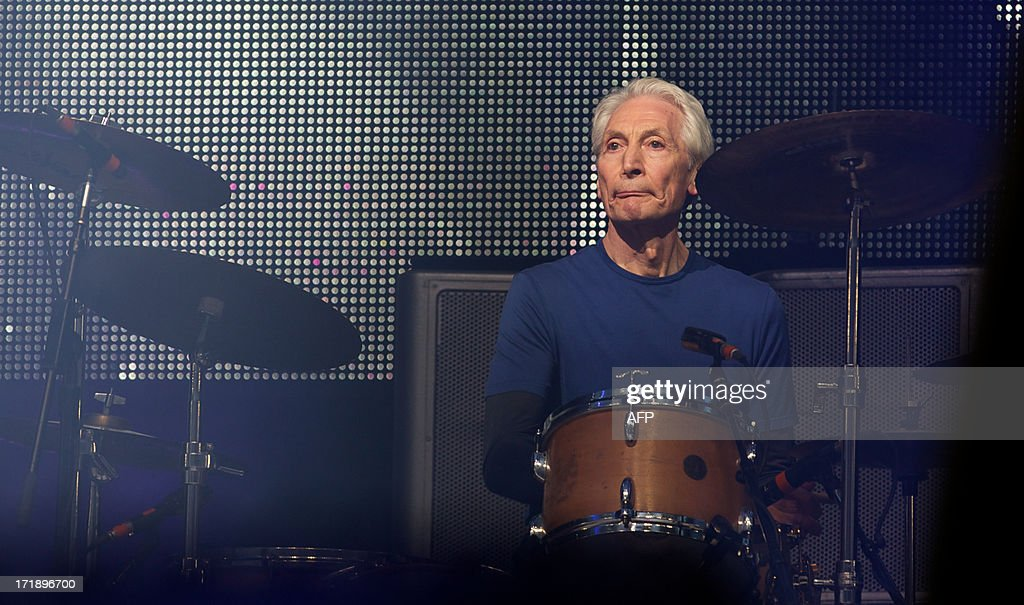 British musician Charlie Watts of the Rolling Stones performs on the Pyramid Stage on the fourth day of the Glastonbury Festival of Contemporary Performing Arts near Glastonbury, southwest England, on June 29, 2013. The festival attracts 170,000 party-goers to the dairy farm in Somerset, and this year's tickets sold out within two hours of going on sale. The Rolling Stones are will perform at the festival for the first time.