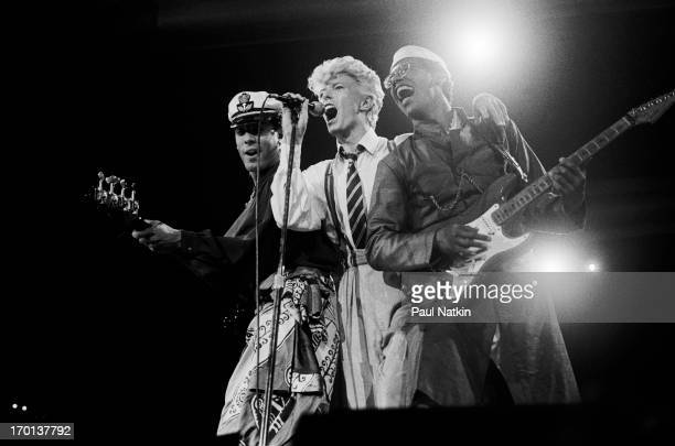 British musician David Bowie performs with Carmine Rojas and Carlos Alomar on stage at the Rosemont Horizon theater Rosemont Illinois August 3 1983