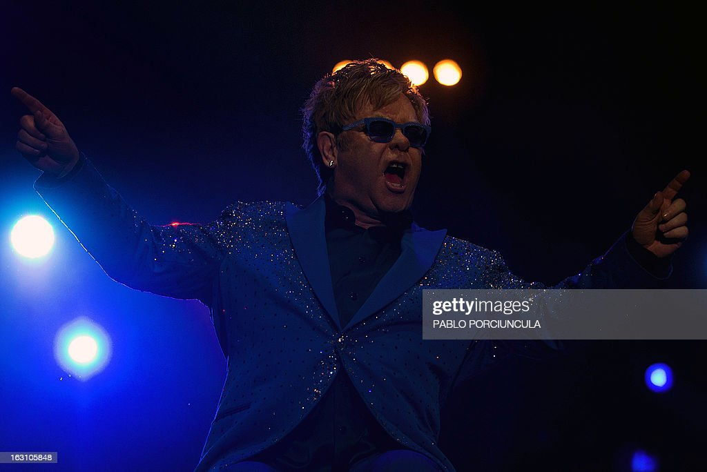British musician Elton John performs at Gran Parque Central stadium in Montevideo on March 4, 2013. AFP PHOTO/Pablo PORCIUNCULA