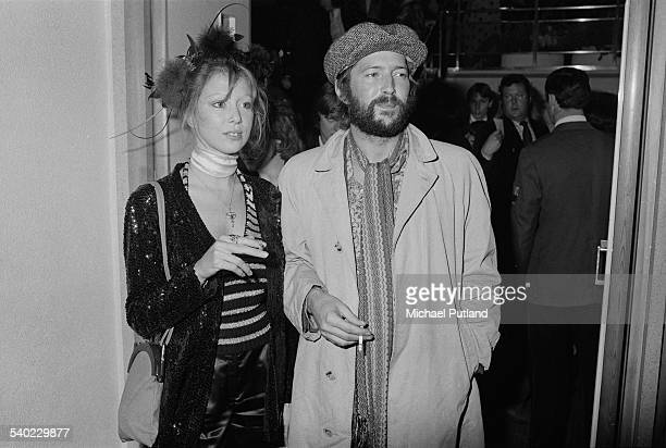 British musician Eric Clapton and his girlfriend Pattie Boyd at the premiere of Ken Russell's film version of The Who's rock opera 'Tommy' at the...