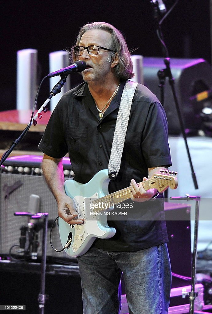 British musician Eric Clapton performs on stage in the western German city of Duesseldorf together with Steve Winwood (not pictured) on May 28, 2010.