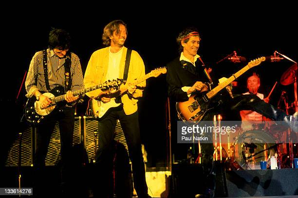 British musician Eric Clapton performs with Ron Wood Keith Richards and Charlie Watts of the Rolling Stones on stage during the band's 'Steel Wheels'...