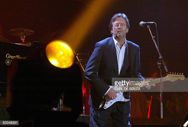 British musician Eric Clapton plays at the Tsunami Relief concert at the Millenuim Stadium in Cardiff 22 January 2005 The concert is to raise money...