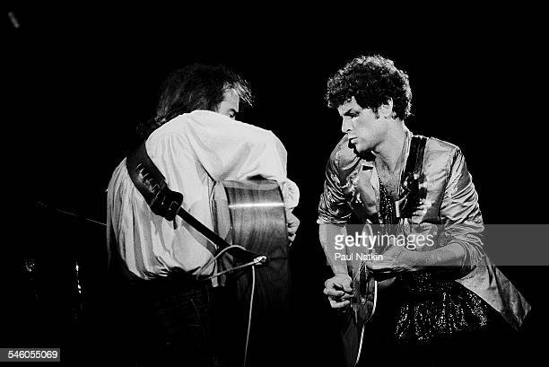 British musician John McVie and American musician Lindsey Buckingham both from the group Fleetwood Mac perform onstage at the Alpine Valley Music...
