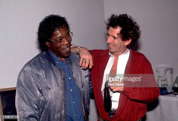 British musician Keith Richards backstage American musician Buddy Guy on the former's 'Main Offender' tour early 1993