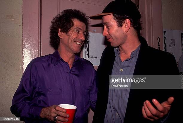 British musician Keith Richards backstage with American tennis player John McEnroe at the Academy for a perfomance with his band the Xpensive Winos...