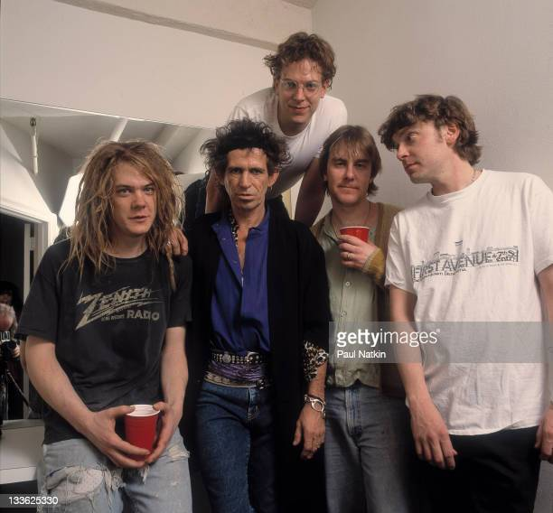 British musician Keith Richards poses backstage with members of the band Soul Asylum on the former's 'Main Offender' tour early 1993 Pictured are...