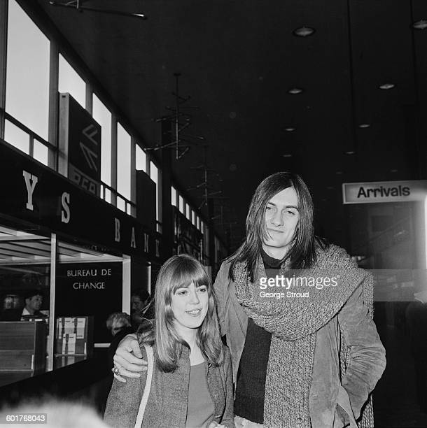 British musician Mick Fleetwood of Fleetwood Mac with his girlfriend model Jenny Boyd at London Airport UK 17th February 1970 The couple were married...