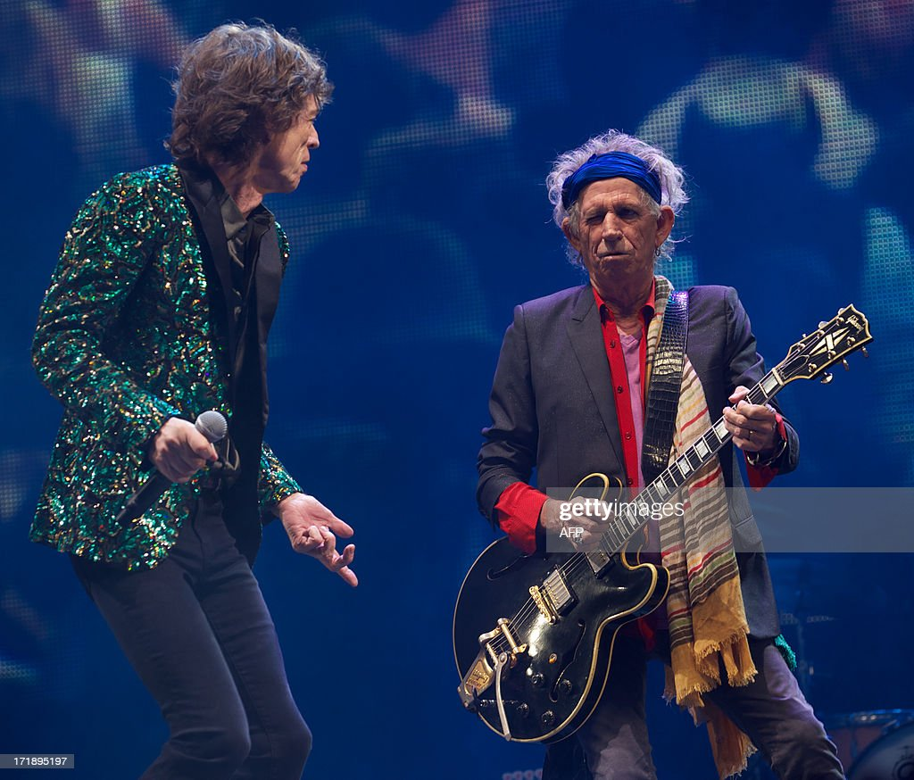 British musician Mick Jagger (L) and Keith Richards of the Rolling Stones performs on the Pyramid Stage on the fourth day of the Glastonbury Festival of Contemporary Performing Arts near Glastonbury, southwest England, on June 29, 2013. The festival attracts 170,000 party-goers to the dairy farm in Somerset, and this year's tickets sold out within two hours of going on sale. The Rolling Stones are will perform at the festival for the first time.