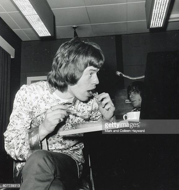 British musician Mick Jagger of the group the Rolling Stones eats lunch during a break at Olympic Studios London England May 23 1967 The band were in...