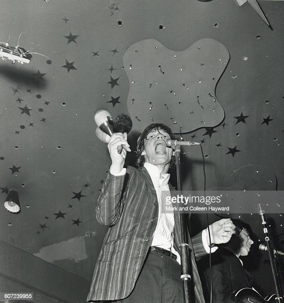 British musician Mick Jagger of the group the Rolling Stones performs onstage 1964
