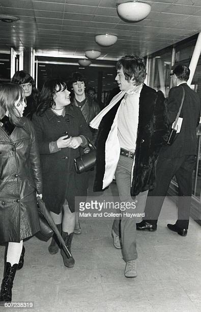 British musician Mick Jagger of the group the Rolling Stones talks with fans who follow him through an airport corridor New York New York January 15...