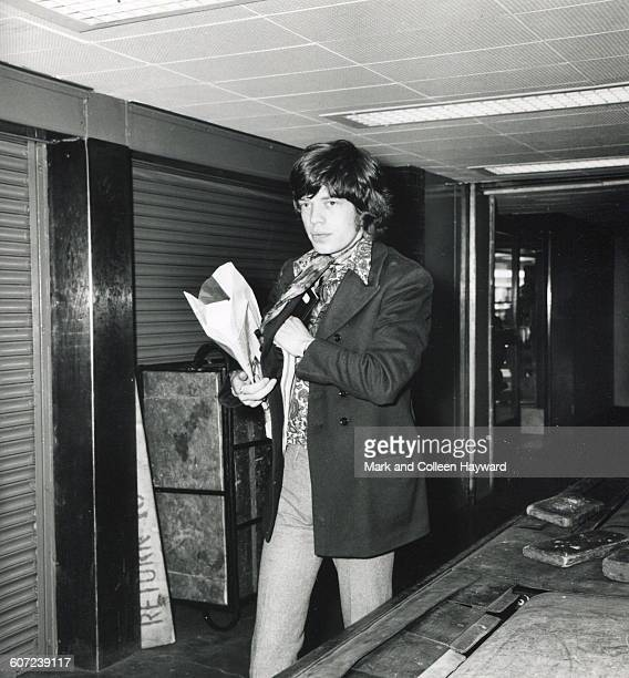 British musician Mick Jagger of the group the Rolling Stones walks through Heathrow airport London England April 12 1967