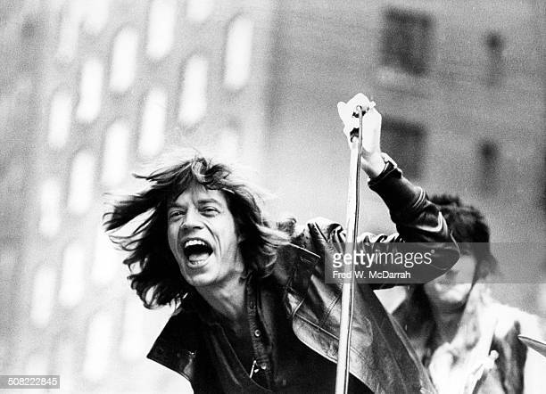 British musician Mick Jagger of the rock band the Rolling Stones performs on a flatbed truck on 5th Avenue as the band announce their 'Tour of the...